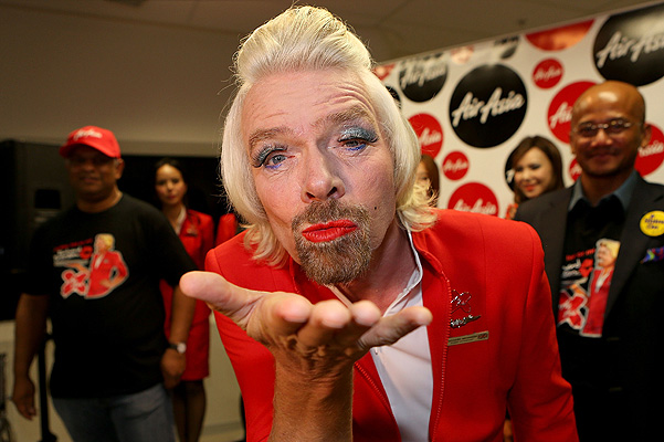 """Stewardess"" Richard Branson Serves Passengers On AirAsia Flight"