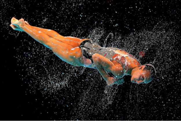 quinn_rooney_syncro_spin_-_a_team_member_from_canada_is_thrown_in_the_air_during_the_synchronized_swimming_free_combination_final_of_the_15th_fina_world_championships_at_palau_sant_jor79